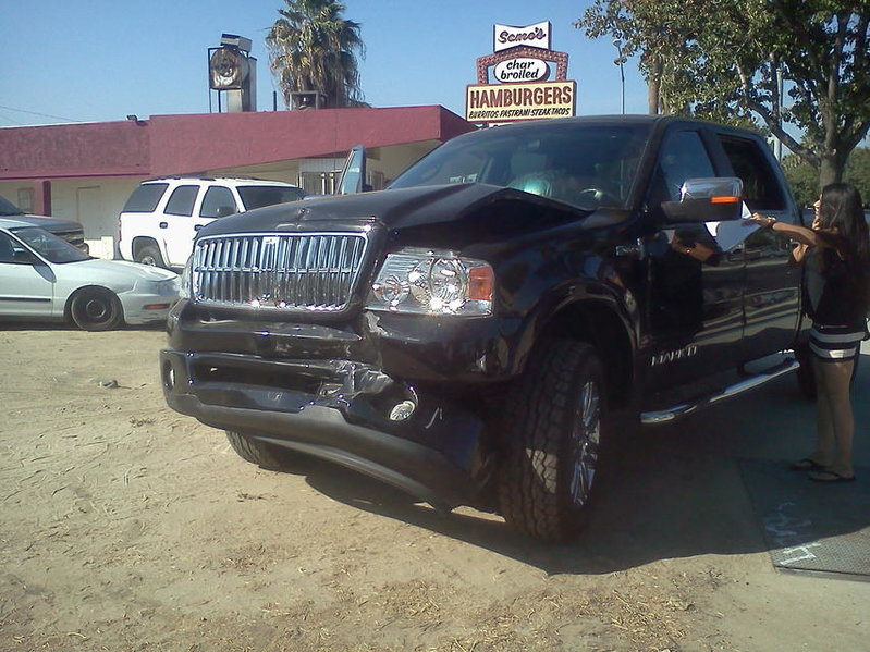 Rear-ended today. Tacoma vs. Lincoln Mark LT-1002121532b.jpg