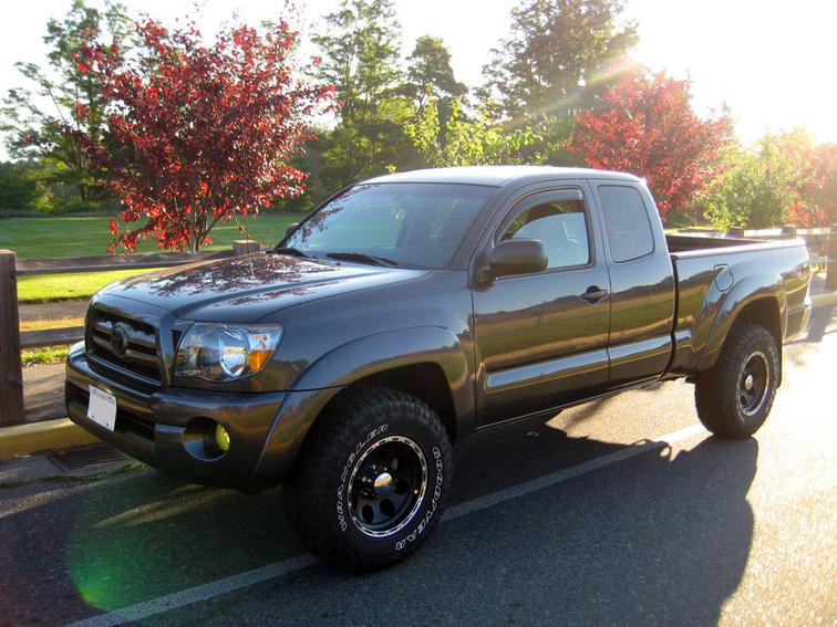 pics of tacomas with 265/75/16 without lifts?-img_2178.jpg