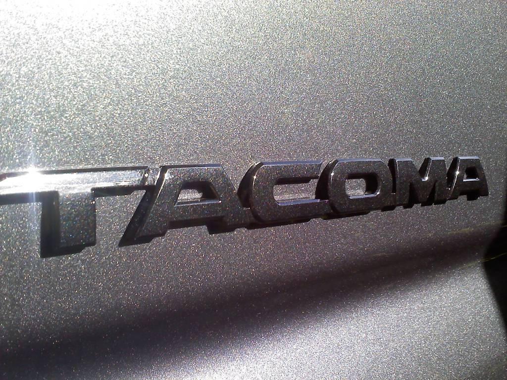 black truck red emblems tacoma world. Black Bedroom Furniture Sets. Home Design Ideas