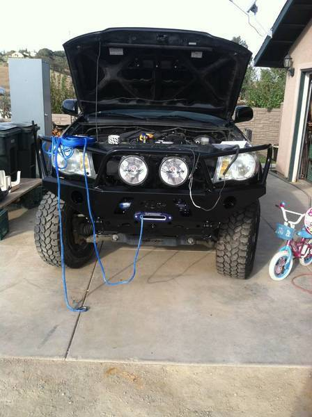 show us your winches not your wives page 27 tacoma world i relocated the solenoid pack to behind the top passenger side of the grill and mounted it on a custom bracket i welded in i clocked the disengage lever