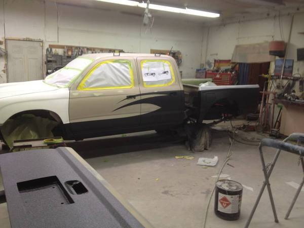 Getting the bedliner paint job done after the GU fiberglass installed.