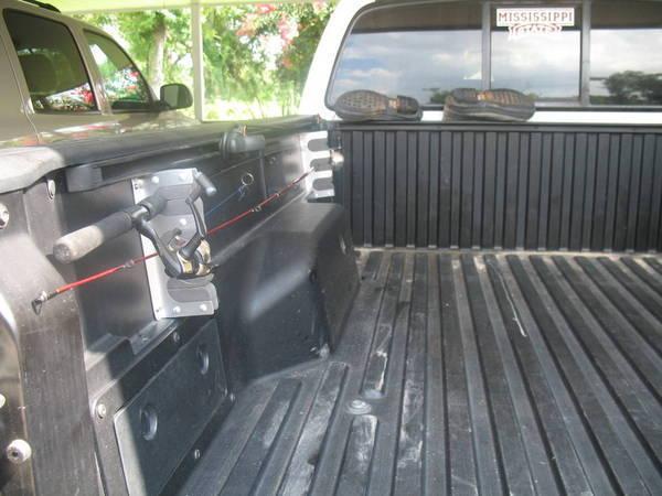Vehicle fishing rod holder vehicle ideas for Fishing rod holder for truck