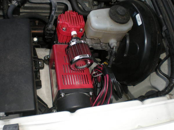 air compressor mounted under hood