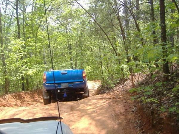 eddie going thru a trail......blue balls in tow!!!