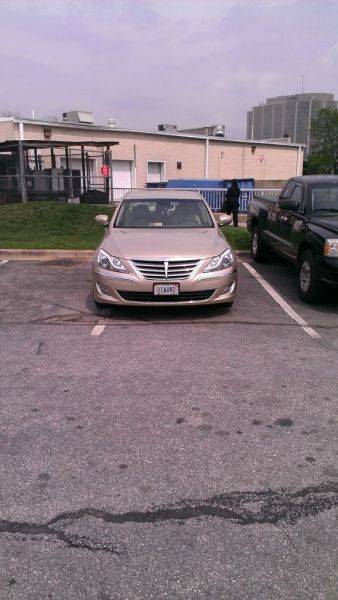 Plate should say dumass. Full parking lot and hes 2nd spot from door.