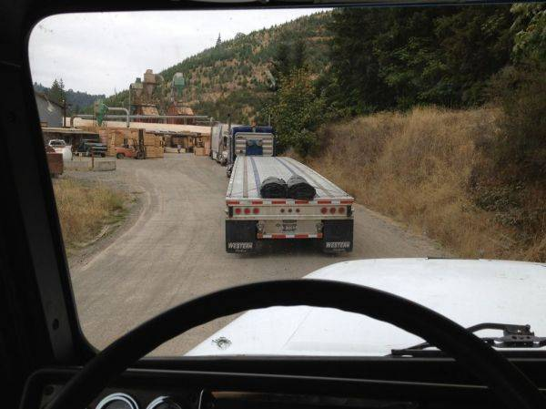 In line to get loaded at a Lumber Mill