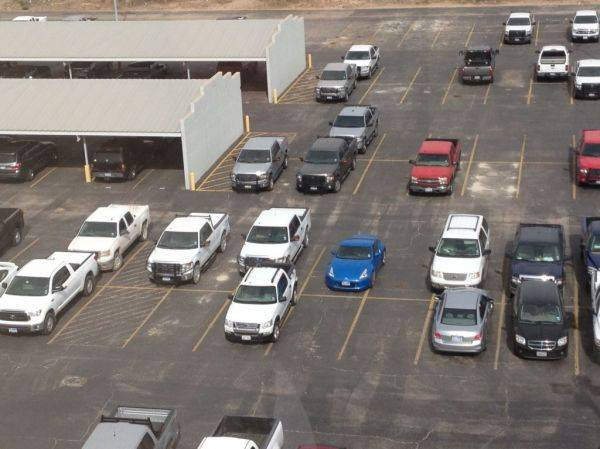 How many improperly parked cars and trucks can you find?