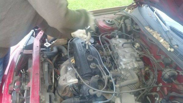 Jasmine replace spark plugs and wires on her girlfriends car