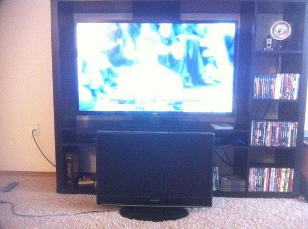 "Out with the old (32"") in with the new (55"" LED). :woot:"
