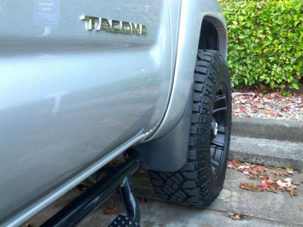 "Dremeled 7"" off the Dumbo-eared front mud flaps"