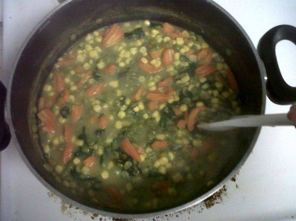 Freshly made split pea soup with sweet corn, spinach and chopped carrots. Y