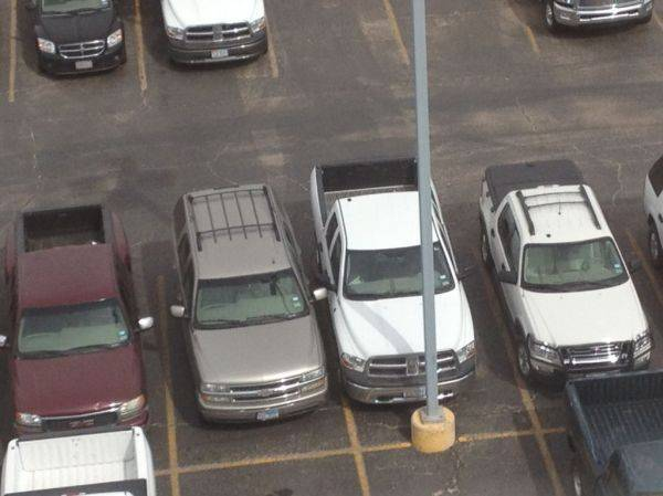 Latest edition of the parking lot. Mirrors touching.