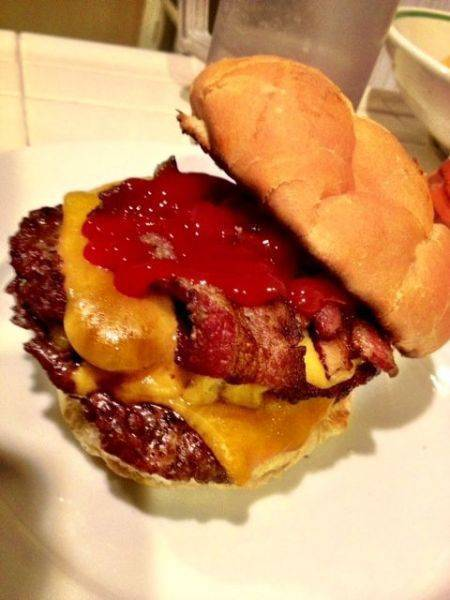 Valentine's double bacon cheeseburger homemade on the grill present to
