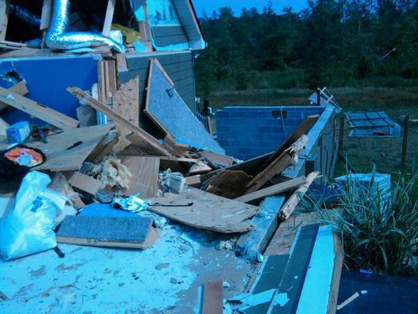 The wall w/siding used to sit up on block wall 8' away, until tornado