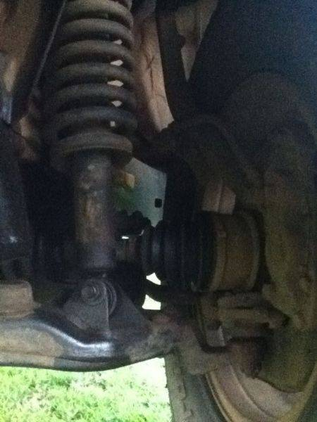Front suspension, see something wrong with the bottom coil spring mount?