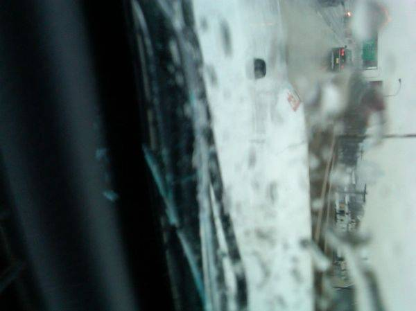 Windshield washer blue crystals on my dash. Glass cracked on both sides all
