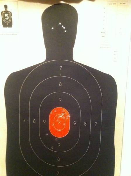 Not bad for my first time shooting a hand gun. 15 yards 25 total 5 in the h