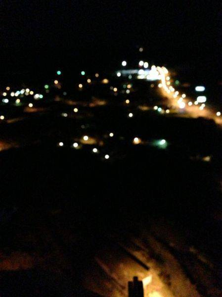 Sitting atop a tower in searchlight.